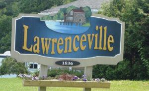 Panneau à l'entrée du village de Lawrenceville